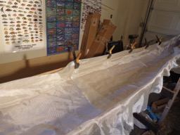 4/6/16 - Fiberglass cloth is laid in the hull.