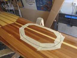 The outline for the forward hatch is traced on the deck.