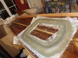 4/9/16 - The aft hatch lip is made from several layers of laminated fiberglass.