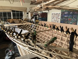 11/19/17 - The overhanging ribs are cut off and inwale spacer blocks are epoxied to the gunwale.