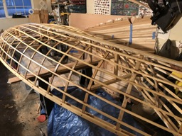 12/8/17 - The underside of the wood frame is sealed with epoxy and the keelson is fiberglassed.