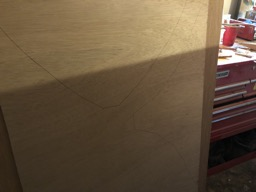 The outlines for the under seat bulkheads are traced on marine plywood.