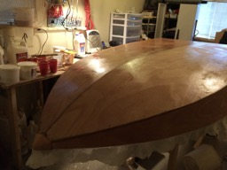 The excess cloth will be trimmed when the epoxy cures.