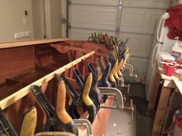 12/30/13 - One of the rails is installed. When boat building, you can never have too many clamps!