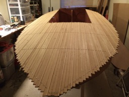 1/2/14 - The custom strip deck is fully glued. It will be sanded smooth and trimmed before fiberglassing.