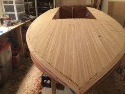 The edge strips are planed down to the level of the rest of the deck. Next comes sanding and fiberglassing.