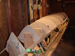 10/18/07 - The sheer strips are hot-glued in place.  The port side has the second strip in place as well.
