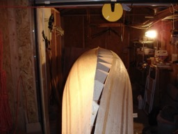The strips are sawed off in a straight line to match the keel line.