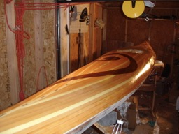 11/21/07 - The extra cloth is trimmed and a fill coat of epoxy is added.
