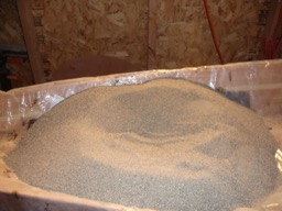 Sand is placed over the layup to ensure all the fiberglass cloth lays flat.