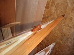 A third cable exit is epoxied in place.  This will be the guide for the cord that raises and lowers the rudder.