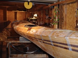 The deck is taped to the hull with strapping tape.  A thin bead of epoxy is run around the sheer joint to reinforce it.