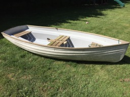 The boat is in rough shape after sitting on a dock for 20 years.