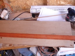 8/10/08 - Sheets of plywood and a piece of bloodwood are epoxied together for use as the leeboard.