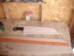 The rudder and leeboard are sanded and ready for fiberglass.