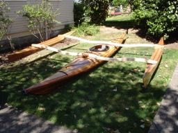 After holes are drilled for bolts in the amas they are put together and laid on the kayak.